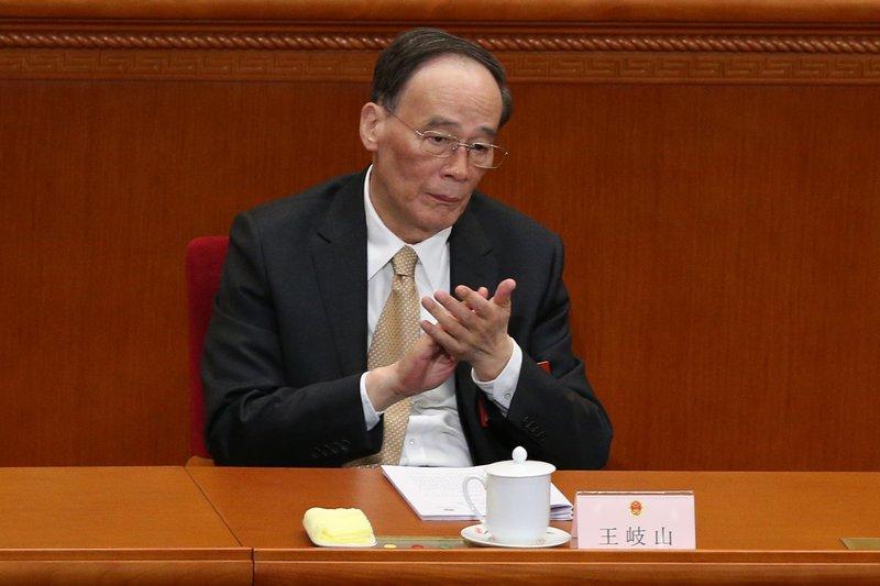 Wang Qishan, 69 ára agameistari flokksins, hefur leitt herferð gegn spillingu í flokknum og þykir sérlega hliðhollur Xi Jinping forseta í þeim störfum.  MYND: EPA